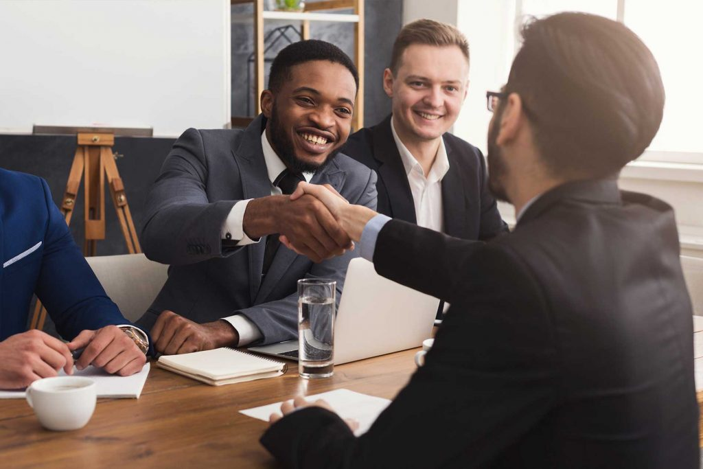 business handshake at office meeting